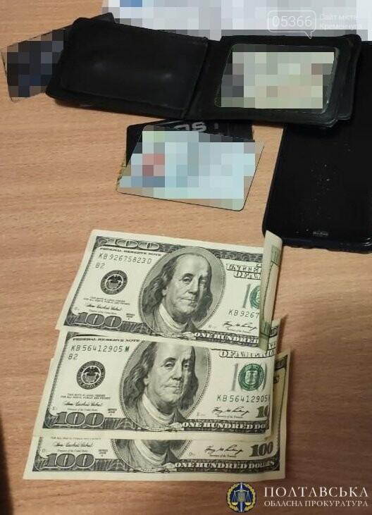 Вимагав гроші з власниці сайту знайомств: затримано поліціянта, фото-1
